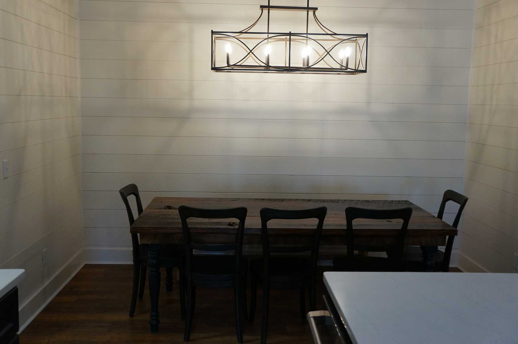 Cute dining area with unique lighting.