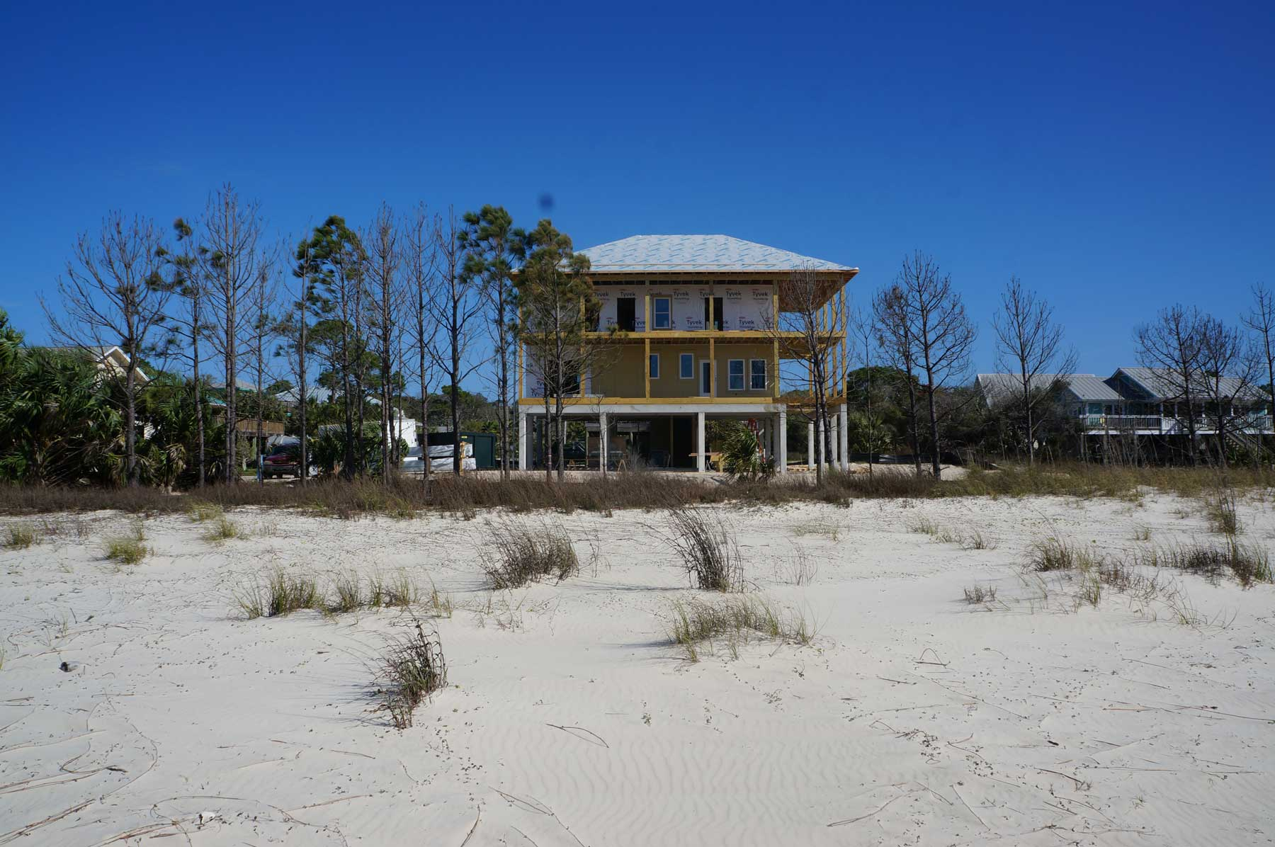 Sand in the front yard goes to beach.