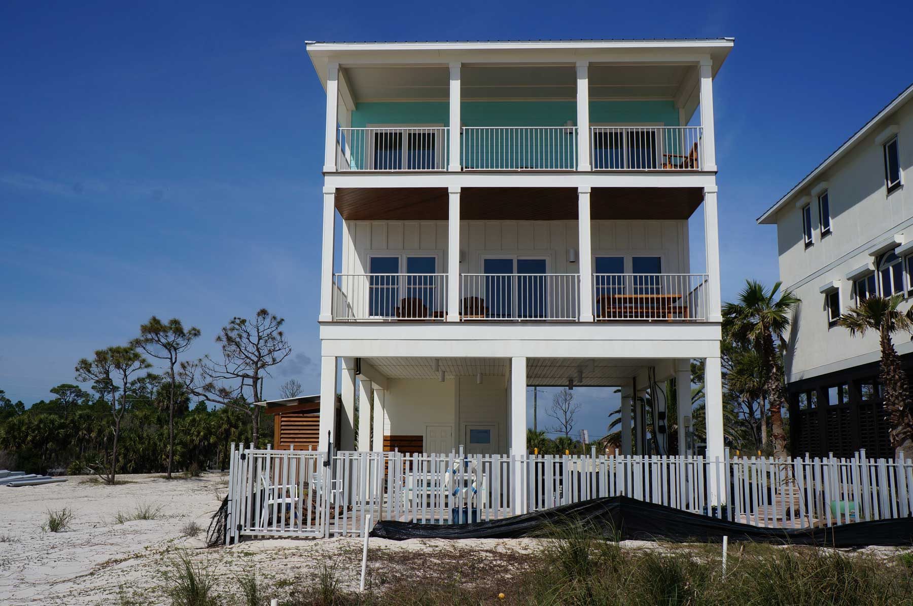 Exterior view of three story home nearing completion by our Mexico Beach FL home builders.
