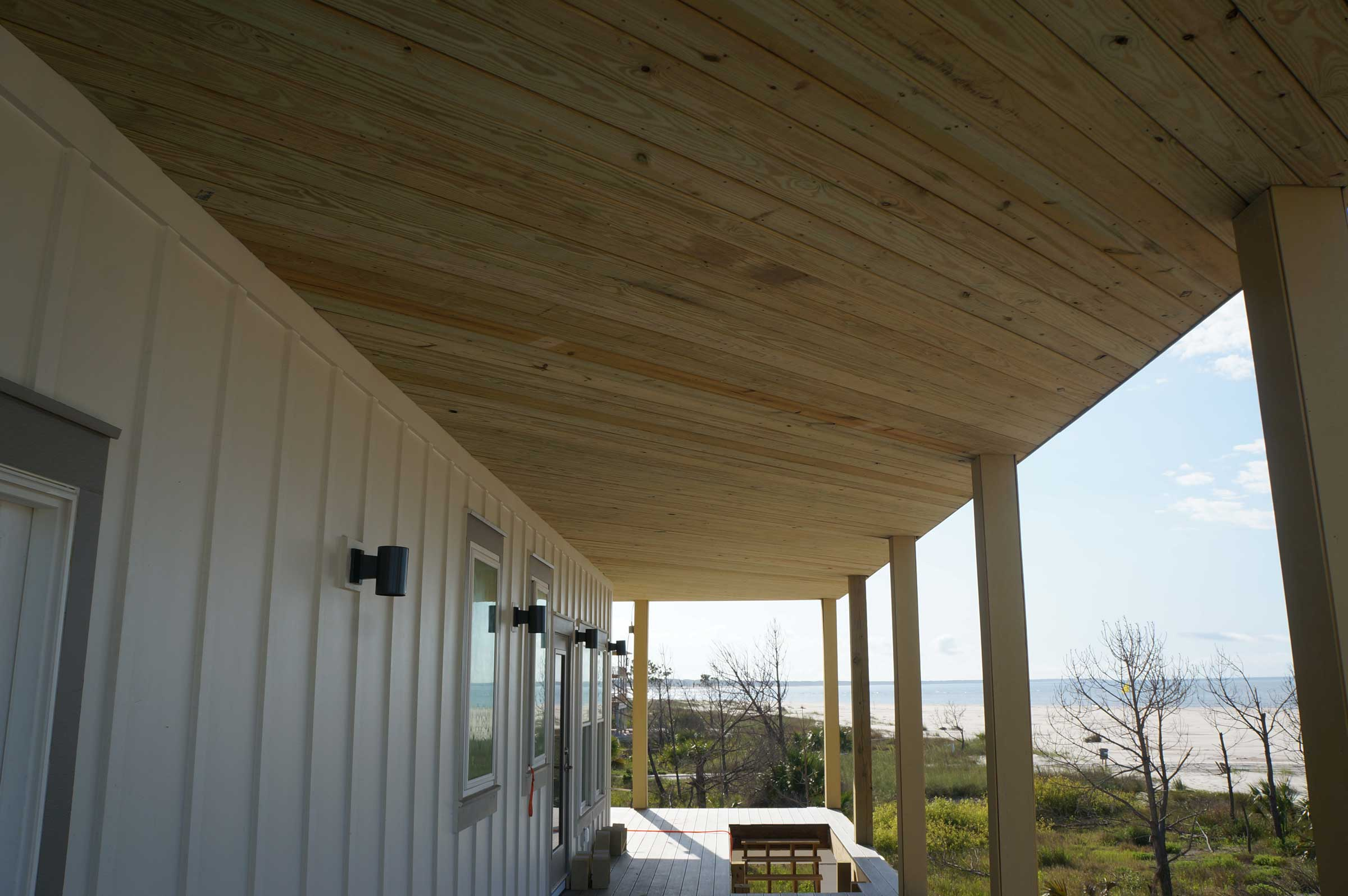 Wood plank covering over second floor deck.