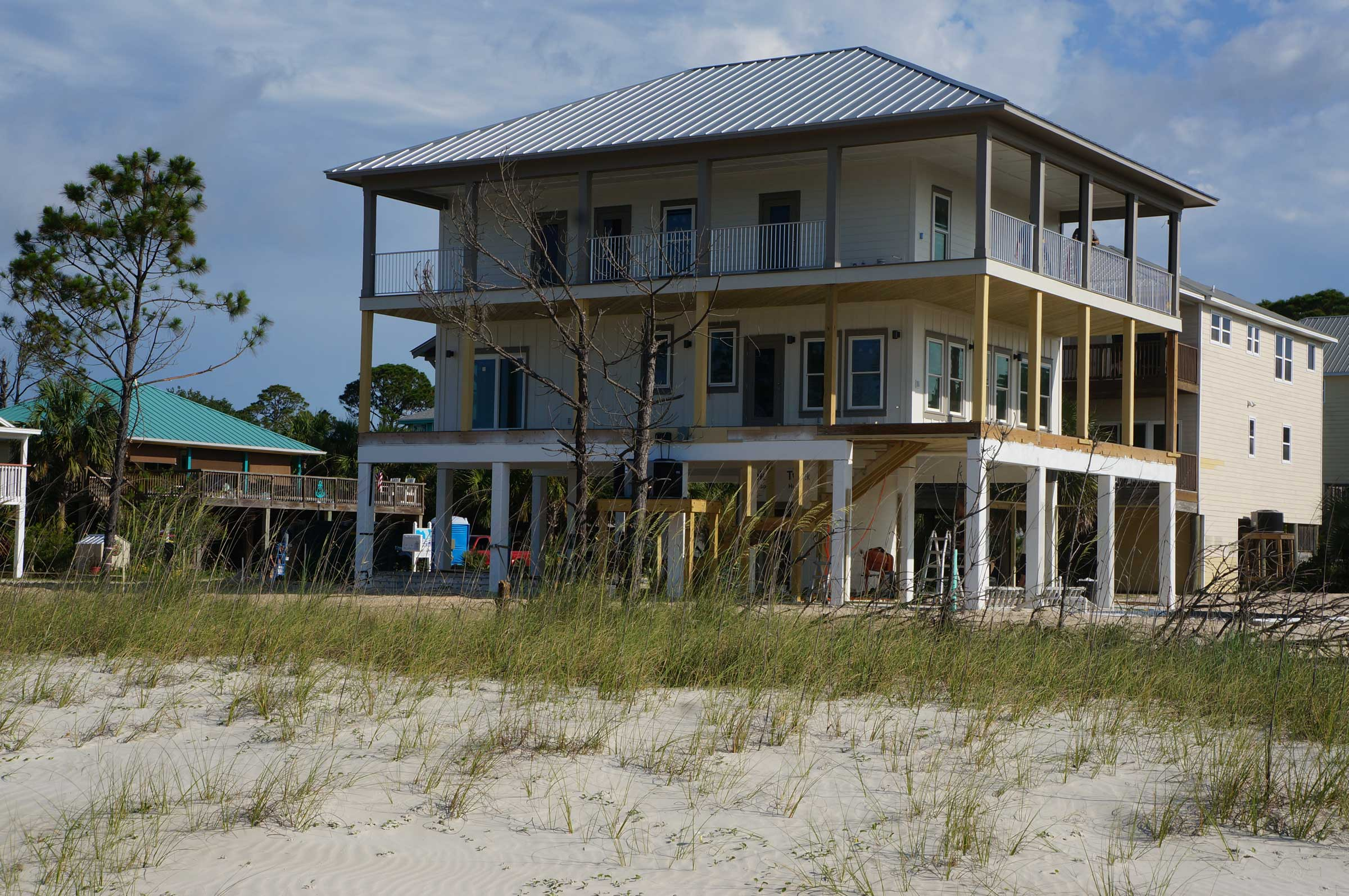 Front view of new construction home in Mexico Beach. Waterfront homes by Gulf Building Company of Port St Joe.