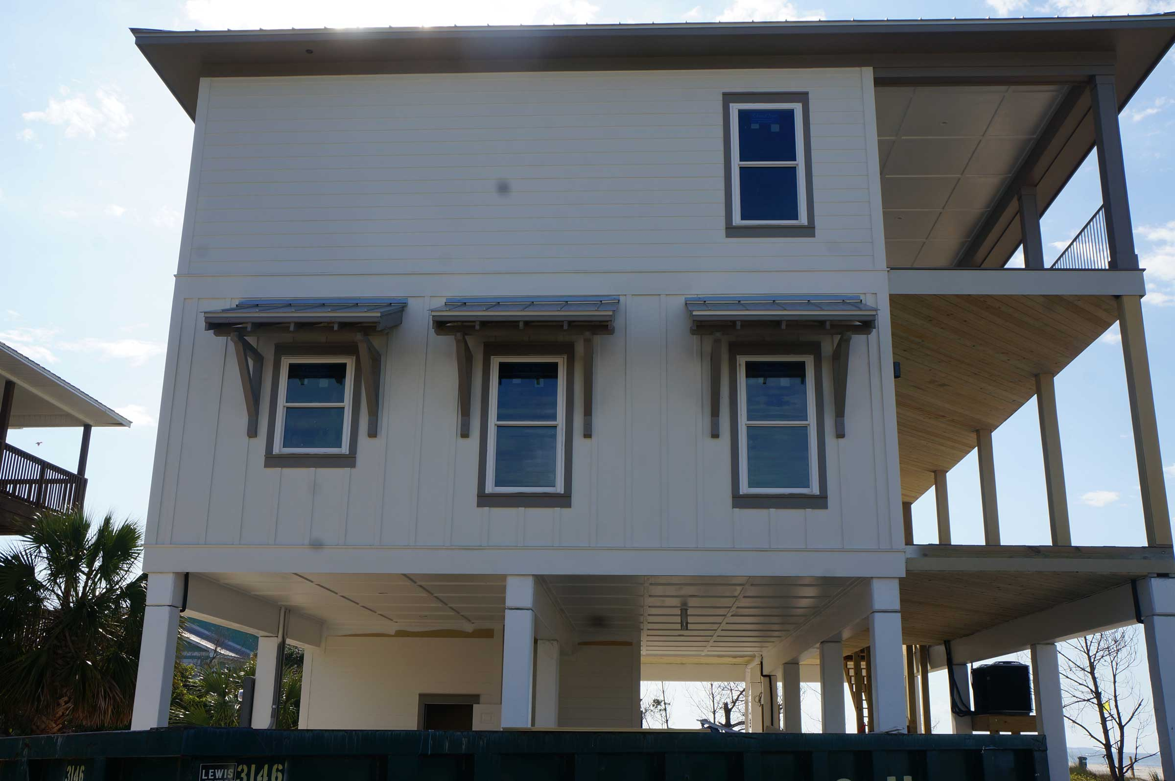 Exterior view of windows with outside shade covers.