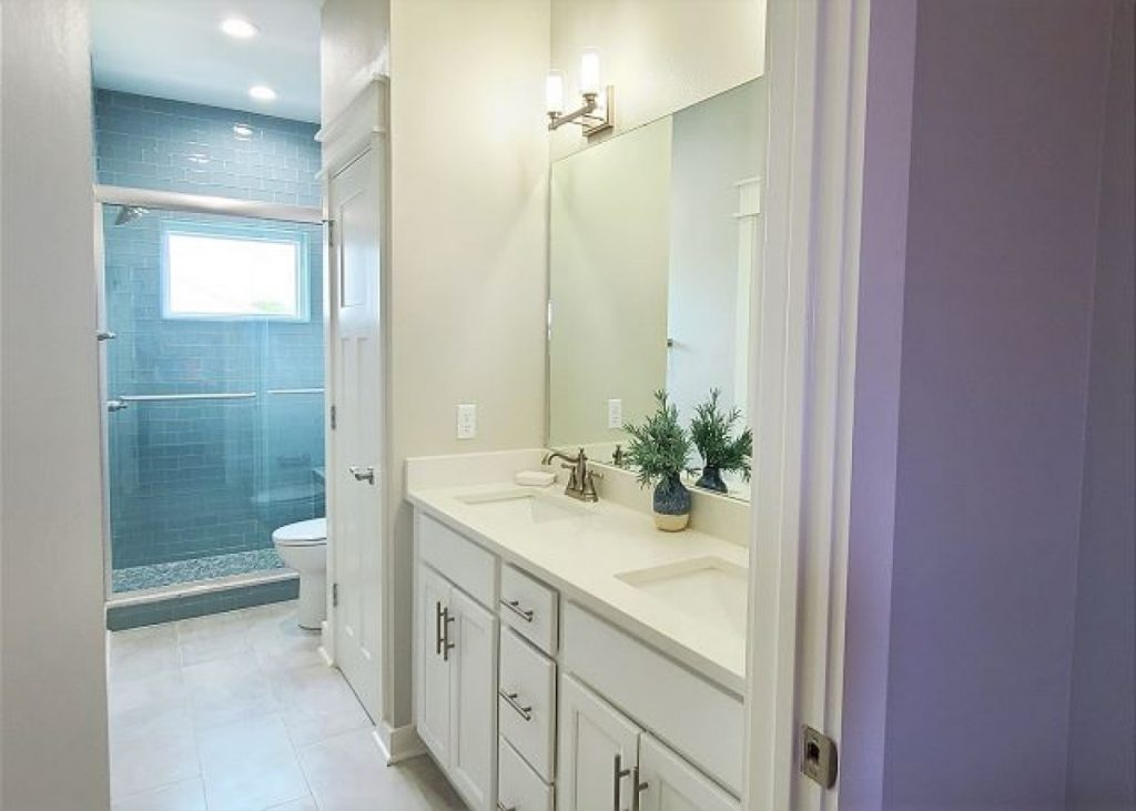 bright bathroom with big shower