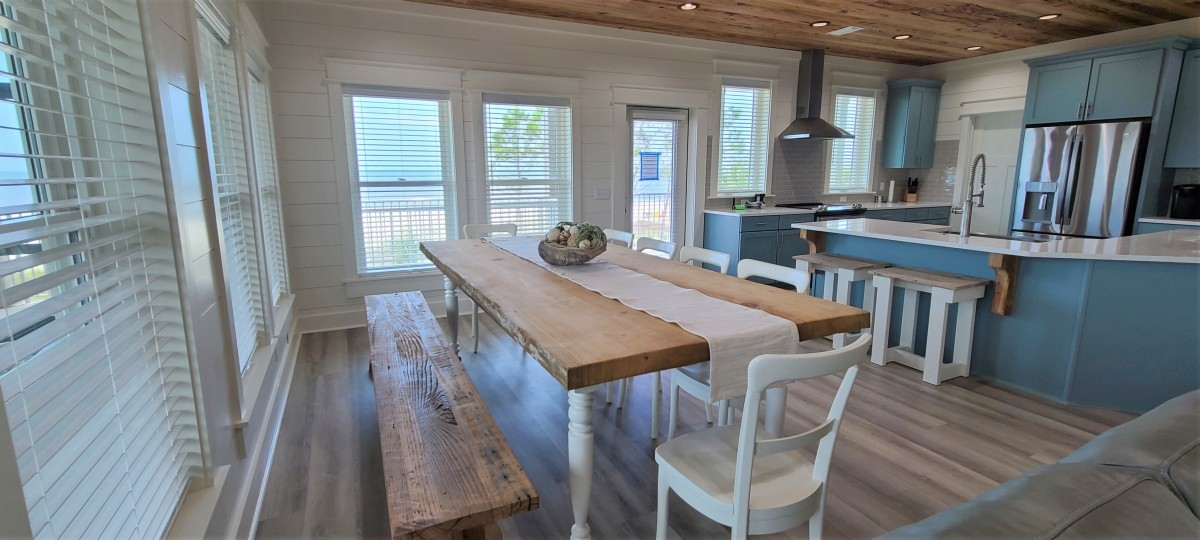 large dining area in front of big windows