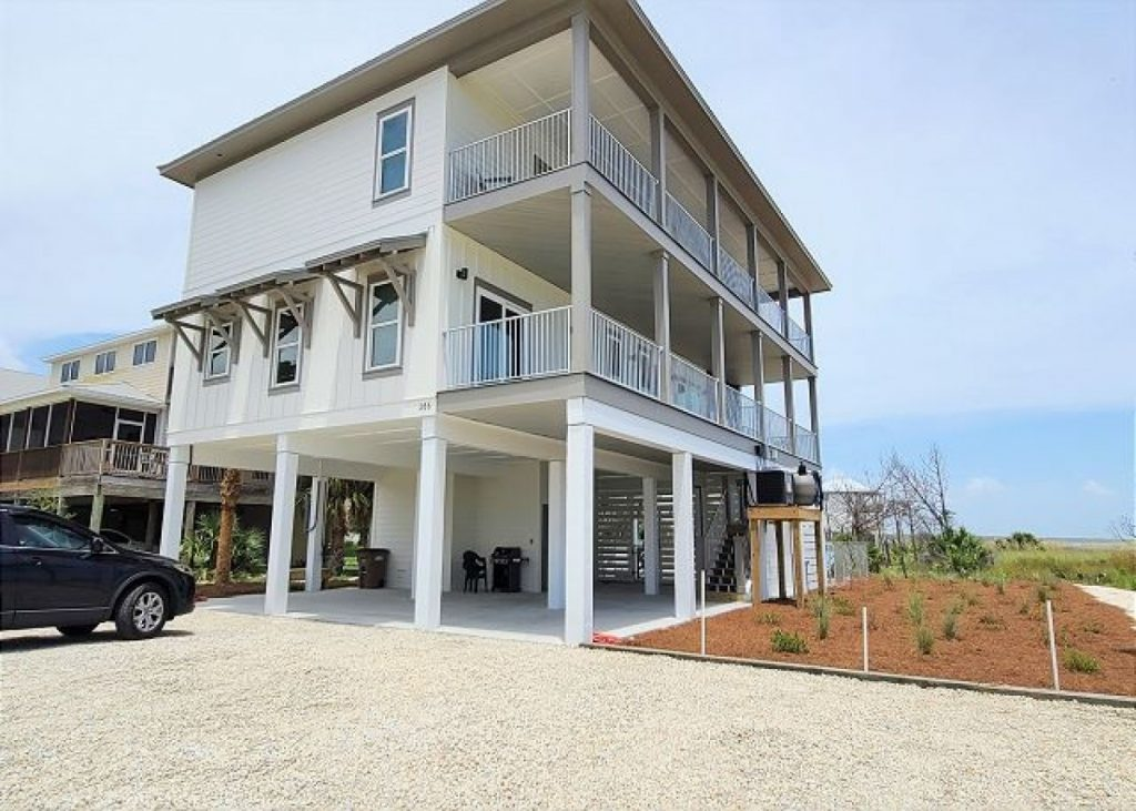 angle view of the three story new home on stilts