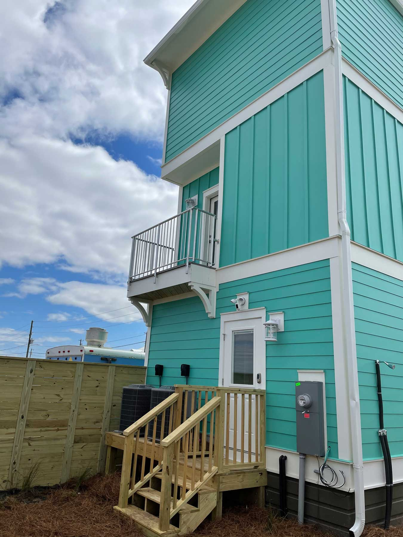 Back view of new home with wrap around porches
