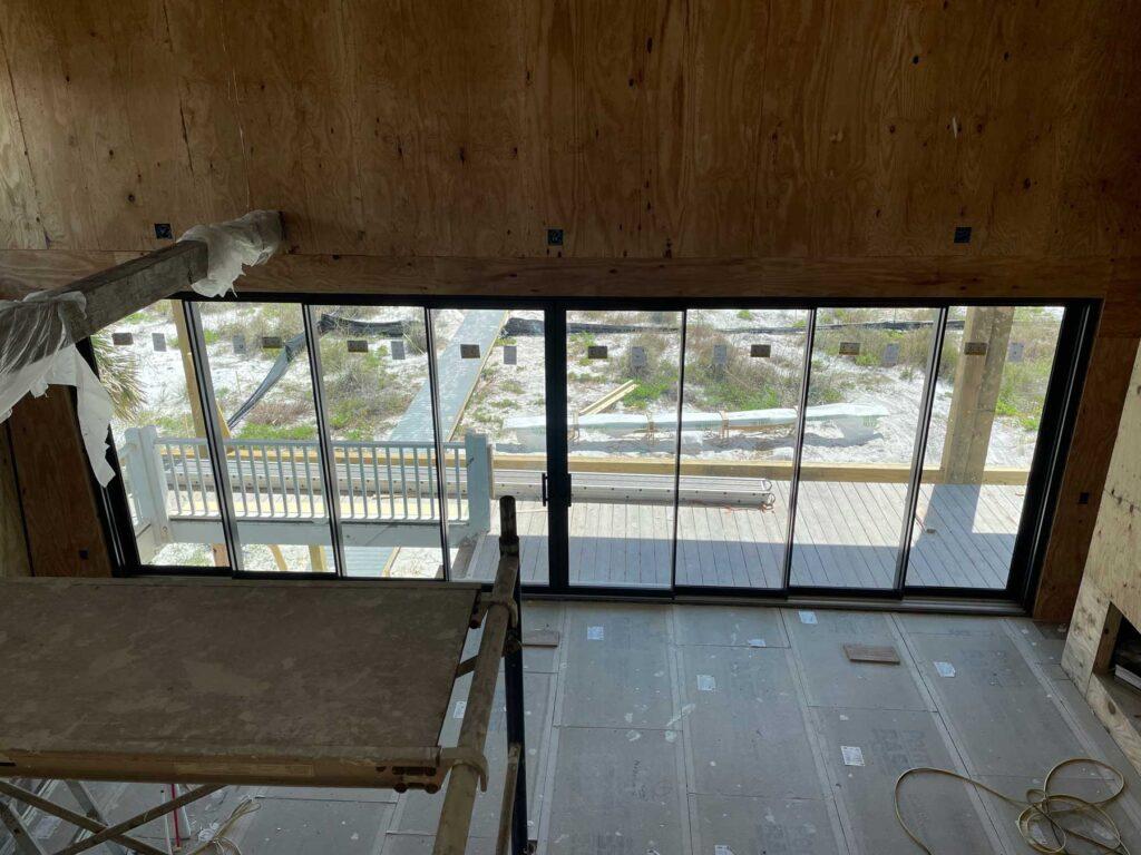 New tall windows - wall of windows on home reno.