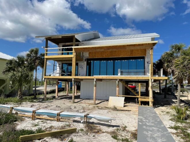 Exterior of home being rebuilt.