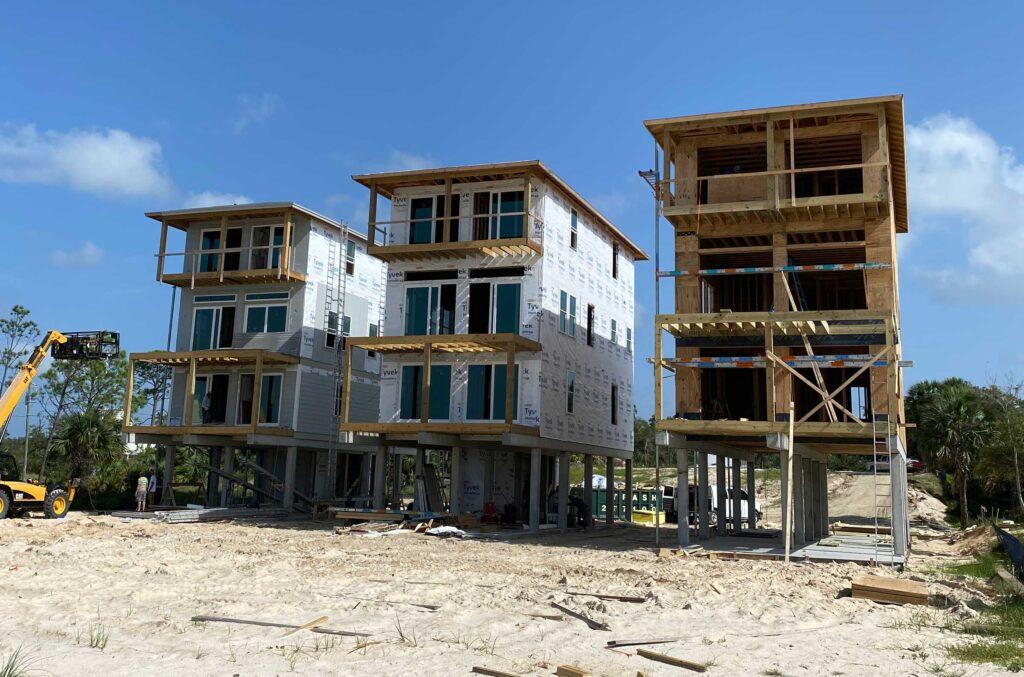 Three new homes under construction in Northwest Florida.